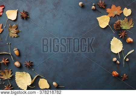 Autumn Background, Frame Made Of Dried Yellow Leaves And Acorns With Copy Space. Seasonal Compositio