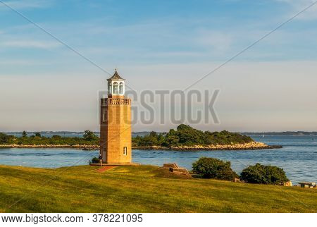 The Avery Point Lighthouse In Groton, Connecticut, On Sunset