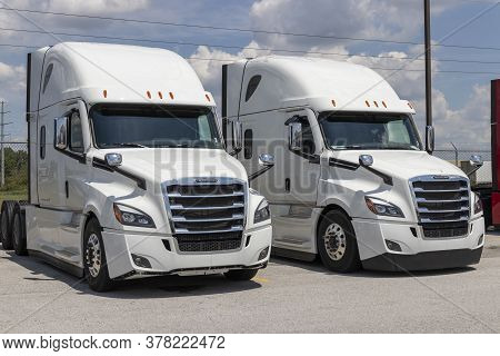 Lima - Circa July 2020: Freightliner Semi Tractor Trailer Trucks Lined Up For Sale. Freightliner Is