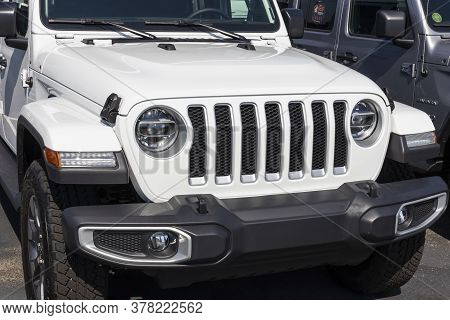 Noblesville - Circa July 2020: Jeep Wrangler Iconic Grille At A Chrysler Jeep Dealership. The Subsid