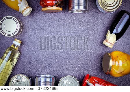 Various Canned Vegetables, Meat, Fish And Fruits In Tin And Glass. Canned Food On Gray Background, T