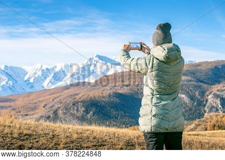 Travel Hike Woman Hiker Taking Photo With Phone Of Landscape Of Trail Hiking In Altai Autumn Mountai