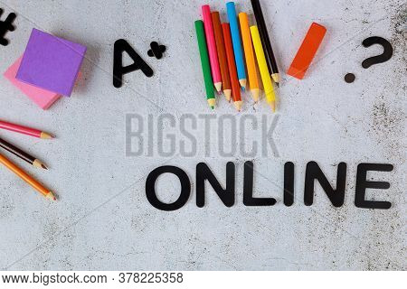 Word Online And School Supplies On White Background. Online Or Homeschool Concept.