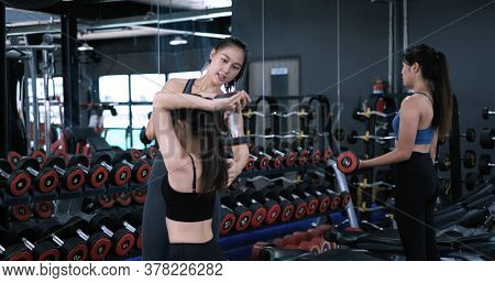 Bodybuilder Of Women Training With Dumbbell Exercise Workout At Fitness Gym In Sportswear With Perso
