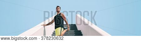 Stretch warm-up leg exercise fit man getting ready to run up the stairs for uphill hiit interval cardio training at outdoor gym. Runner athlete running.