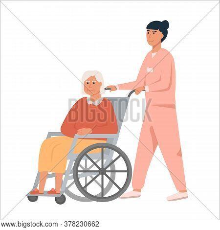 Female Nurse With Old Woman On Wheelchair. Grandmother Sitting On Wheelchair. Retired Elderly Senior