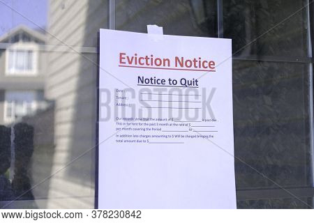 Eviction Notice Served To Tenant Hanging On Front Door