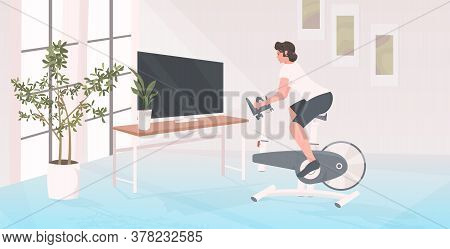 Girl Engaged In Stationary Bike Sport Healthy Lifestyle Concept Living Room Interior Horizontal Full