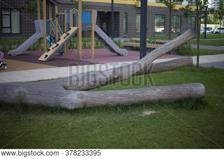 Dry Tree In The Playground. An Old Tree In The Landscape Design Of The Play Area. Natural Materials