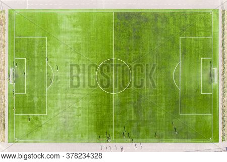 Top View Of Soccer Field, Football Field. Real Football Field Aerial View. Football Players Play On