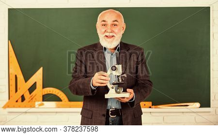 Happy Senior Teacher Use Microscope. Chemistry In School Laboratory. Science Experiments With Micros