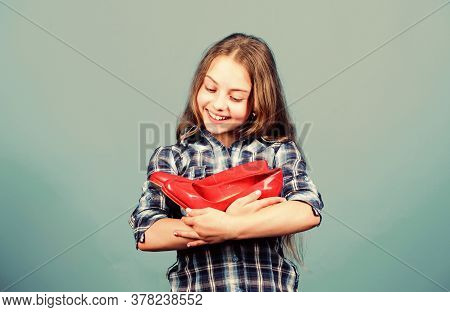 Shoe Care. Happy Childhood. Small Girl With Stylish Shoes. Happy Child Hold Fashionable Shoe. High H