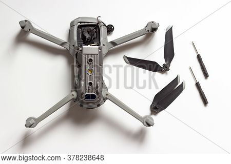 Quadcopter, Propeller And Screwdrivers On White Background, Concept Of Drone Repair.