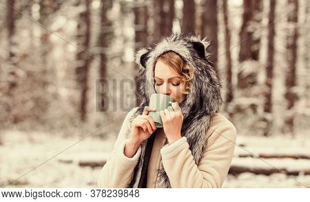 Best Holiday. Warm Yourself Up. Woman Winter Drink. Girl Enjoy Mulled Wine. Woman In Hat Drinking Te