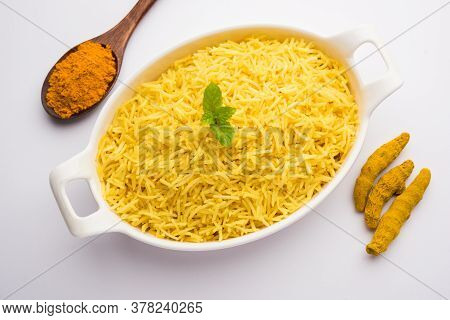 Cooked Turmeric Rice With Curcumin Or Haldi Powder, Indian Food