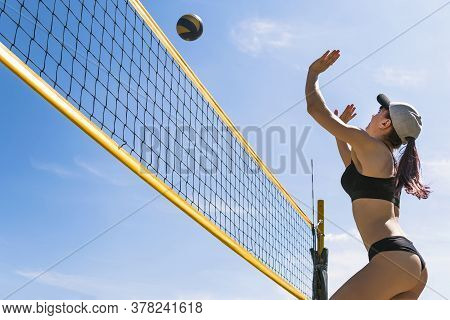 Summer Vacation, Sport And People Concept. Young Woman With Ball Playing Volleyball On Beach. Beach