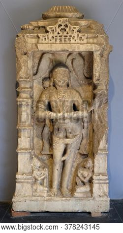 MUMBAI, INDIA - FEBRUARY 14, 2020: Statue of Jaina Devotee from 12th century exposed in the Prince of Wales Museum, now known as The Chhatrapati Shivaji Maharaj Museum in Mumbai, India