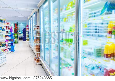 Grocery store refrigerator with various food