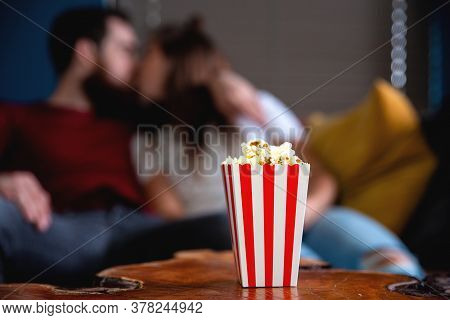 A Young Couple In Love Watching Television At Night Romantic Date Night Lying On The Couch Eating Po