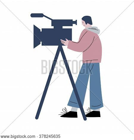 Young Cameraman Working With Camera On Tripod During Cinema Production