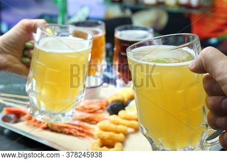 Beer Pub. Langoustines And Beer. Beer And Seafood Snacks. Langoustines, Beer, Squid Rings.