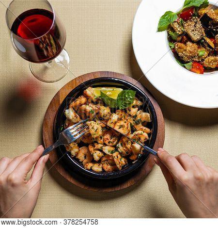 Eating Scampi Shrimp Meal In The Black Pot Plate Close Up