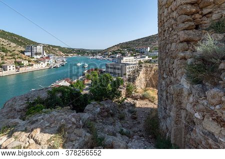 Sevastopol, Crimea - July 3. 2019. View Of The Balaklava Bay From The Genoese Fortress Chembalo
