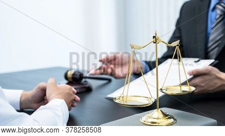 The Scales Of Justice Standing In Front Of The Male Lawyer Who Is Providing Service To Consult Busin