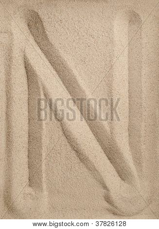 Letter N from sand