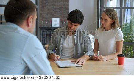 Couple Sign Mortgage Contract, Put Signature On Sale Purchase Rental Agreement, Handshaking Realtor