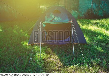 Dark Green Small Tent On Lawn In Front Of Your Own House. New Format Of Rest After Quarantine. Campi