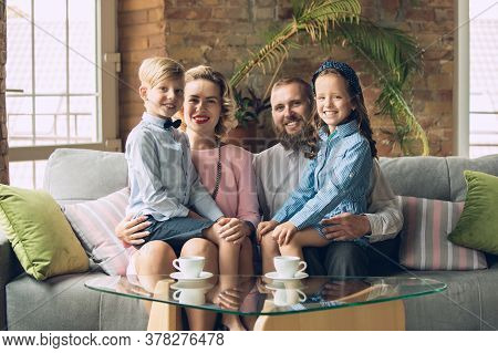 Memory. Happy Family Traditional Portrait, Old-fashioned. Cheerful Parents And Kids In Official Styl