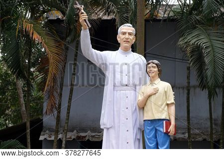 Monument to Croatian Jesuit Missionary Ante Gabric in front of the Catholic Church in Kumrokhali, West Bengal, India