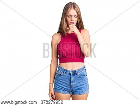 Young beautiful blonde woman wearing elegant summer shirt feeling unwell and coughing as symptom for cold or bronchitis. health care concept.