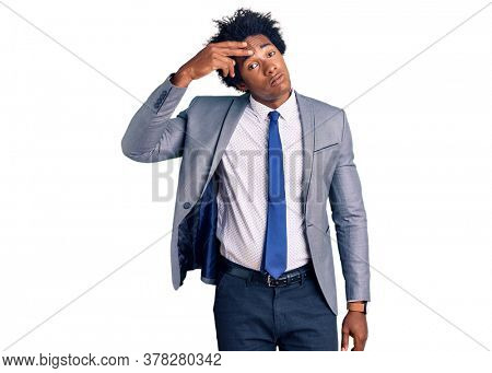 Handsome african american man with afro hair wearing business jacket worried and stressed about a problem with hand on forehead, nervous and anxious for crisis