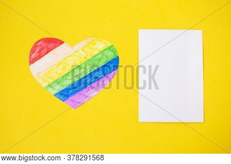 Heart In Lgbtq Colors And White Mockup Blank On Yellow Background, Top View, Copy Space