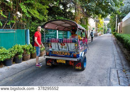 Traditional Tricycle Motorcycle Taxi In Bangkok. Tuk-tuk Taxi In Asia. Bangkok / Tailand - 02.05.202