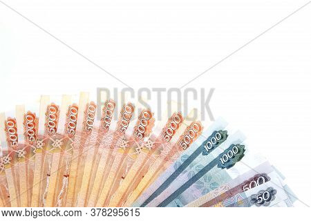 Banknotes Of Russian Rubles Money Lie On A White Isolated Background Top View With An Empty Space Fo