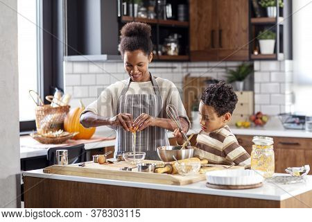 Mum And His Son Cook In The Kitchen
