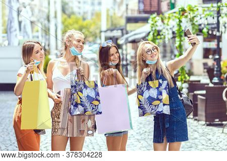 Happy Young Girls Taking Selfie With Open Face Masks While Having Fun At Shopping In City - Smiling