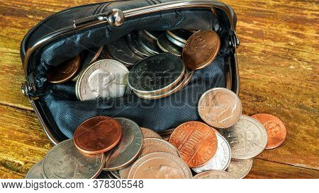 Open Black Leather Pocket Wallet Full Of Various Coins. Financial Crisis, Poverty, Lack Of Money. On