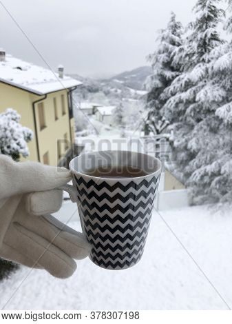 Cup With A Hot Beverage With Smoke On The Winter Snowy Background. Winter Time Concept. Christmas.ve