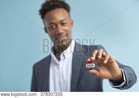 Happy African American Voter Holds Vote Pin For People Who Voted On President Elections 2020 In Usa