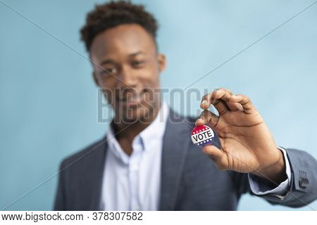 African American Man Showing His Vote Button, He Voted On Elections In The Usa 2020, Blue Background