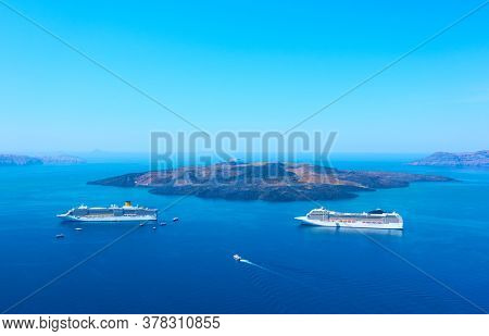 View of Aegean Sea with cruise ships from Santorini island in Greece. Picturesque greek scenery