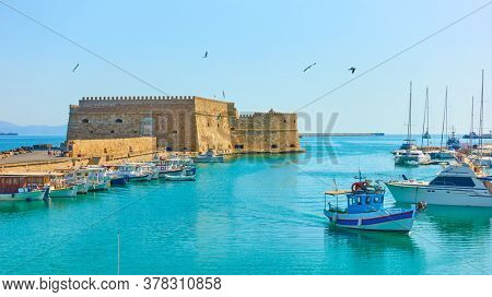 Harbour with fishing boats by the Koules Fortress in Heraklion, Crete, Greece