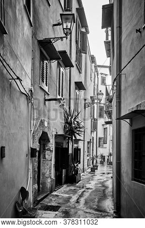 Old side street in Palermo in Sicily, Italy. Black and white urban photography