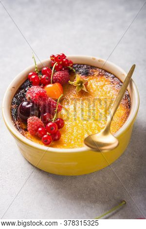Creme Brulee With Raspberry  On Light  Baking Sheet. Space For Your Caption. Creme Brulee