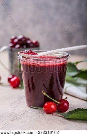 Cherry Jam. Jam In Glass Jar. Homemade Sweet And Sour Cherry Jam With Fresh Cherries On Light Table,