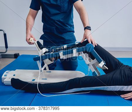 Patient On Cpm Machines. Continuous Passive Range Of Motion.